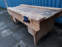 big thick heavy wood industrial work bench with 2 vices