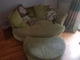 Green cuddle sofa and footstool 2 years old good cpndition