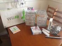 Wii console and x40 games , comes with Wii board as well