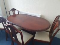 Big extendable dinner table with 6 chairs