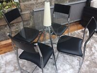 4 leather seat glass dining table