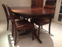 Extendable dining table with 6 chairs - free!