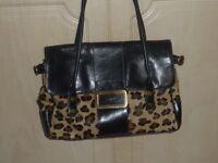 Original Ri2K handbag.Leopard skin and black leather.