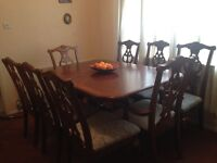 Extendable table with 8 chairs.