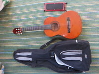 3/4 Guitar, padded case and foot stall