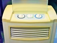 AIR CONDITIONER. LARGE SIZE AND PORTABLE. VARIOUS CONTROL SETTINGS FOR VERY PURE COOL AIR.