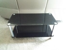 Black glass sideboard, table and TV unit in great condition.