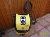 a big karcher pressure washer with patio cleaner