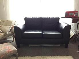 House of Frasers black leather 2 seater