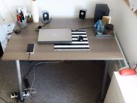 Large desk with adjustable legs