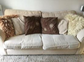 Beige 2-seater sofa bed
