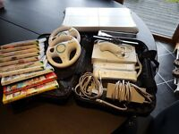 Wii console, with Wii Fit Board, Games, Controllers, Steering Wheels, Stand, Power Pack, Sensor bar