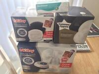 Brand new Nuby electric breast pump + pads