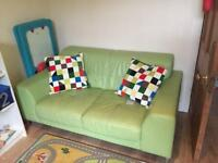 Lime green sofa, single chair and pouffe