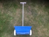 Lawn spreader for seed and feed