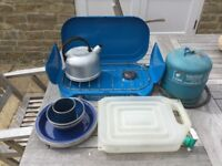 2 ring camping stove, gas bottle, water carrier, plates and bowls