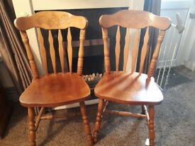 Four solid wood farmhouse chairs