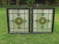Two Pretty opening stained glass windows.