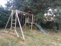 Outdoor climbing frame with monkey bars, climbing wall, tower, slide and swings in Reedham
