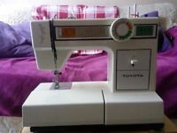 Toyota Sewing machine Model 2260 with original box, tools and accessories