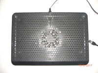 Laptop cooling pad and combination cable lock