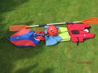 Canoe accessories. Helmet; Spray cover; 2 Lifejackets; Paddle;