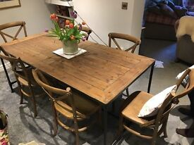 Beautiful table and 6 cross back chairs with stud detail in excellent condition only a year old