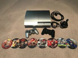 PS3 console + 2 controllers + 8 games