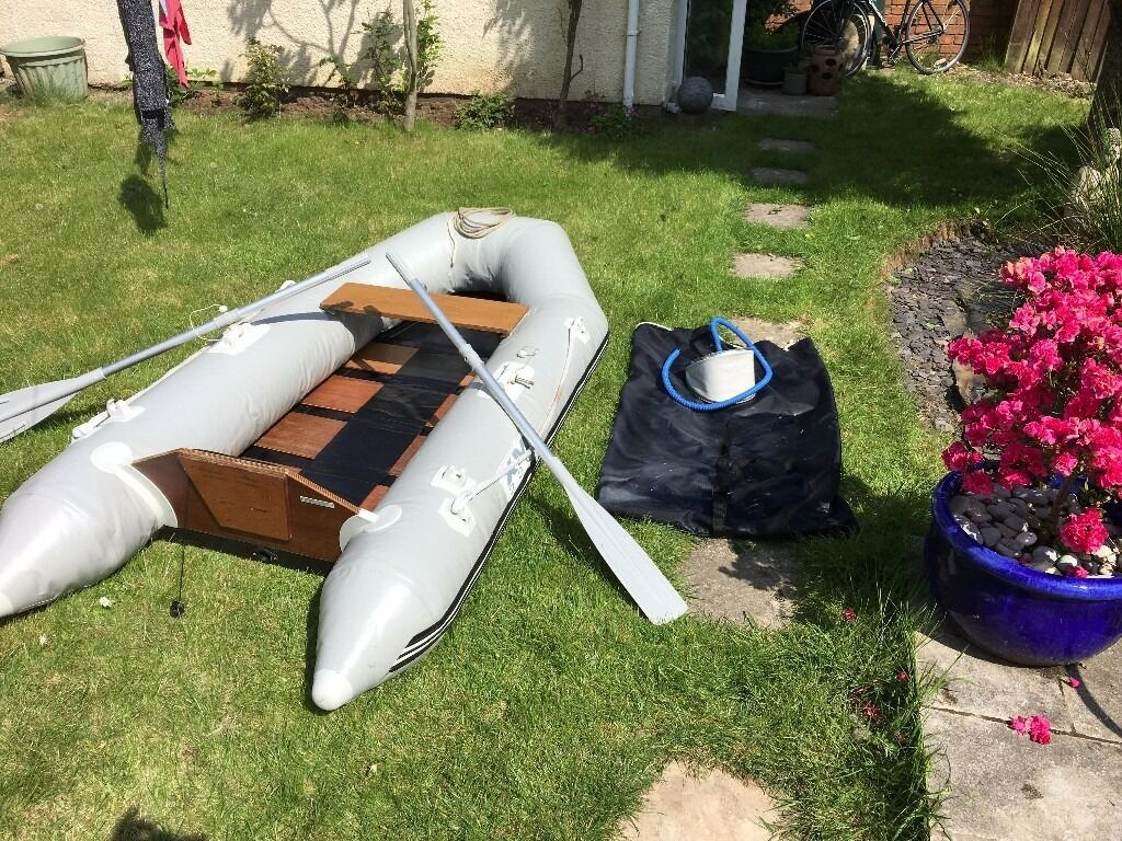 2.3 metre XM inflatable dinghy/tender with oars/pump and carry bag.