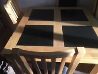 90x90 wooden table with 4 granite inserts and 4 chairs.