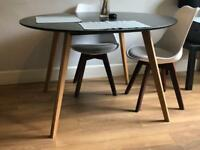 Two year old Charles Jacobs wood dining table 120cm.