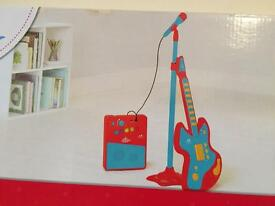 Toy guitar with amp and microphone
