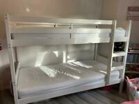 White wooden single bunkbeds