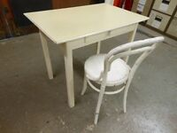 KITCHEN TABLE WITH 1 LARGE DRAWER AND A CHAIR.