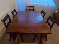 Dining table + 6 chairs. The centre leaf of this table comes out to make it smaller.
