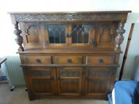 lovely old solid heavy dark brown wood sideboard /display unit with glass doors at the top