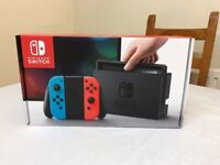 Nintendo Switch With Neon Blue/Neon Red Joy-Con controllers, Zelda, And 1-2-Switch!