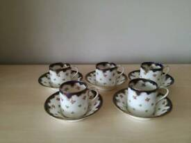 Antique Crown Staffordshire coffee cups and saucers marked Maple & Co