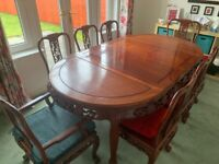 Beautiful Chinese Rosewood extendable dining table with 6 chairs and 2 carvers