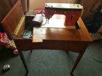 Vintage singer sewing machine with stand
