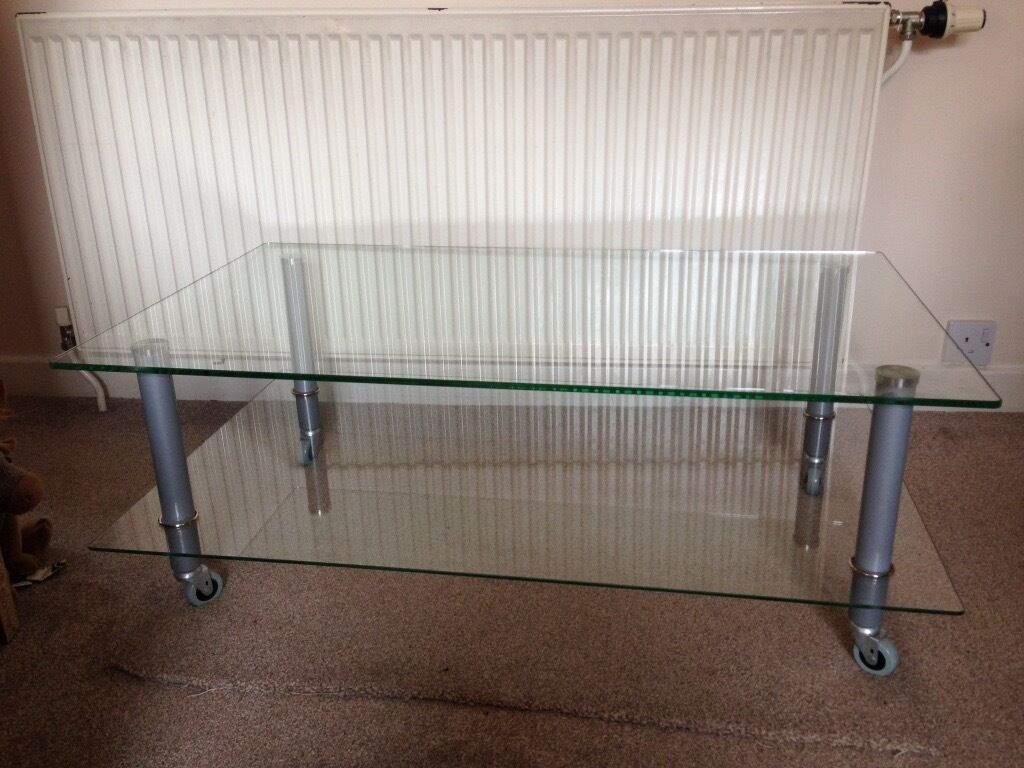 Clear Glass 2 tier tv stand on wheels