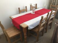 For sale a solid pine dining table with 6 solid pine chairs. (See pictures below).