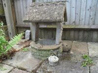 Vintage concrete garden wishing well