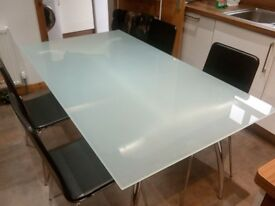 Glass top kitchen/dining table & chairs x4 (from smoke/pet free home)