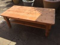 FREE. Large solid pine coffee table 4'x 2'. Needs stripping and revarnishiing/painting.