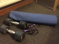 Two 5-kg dumbbells, exercise mat and skipping rope.
