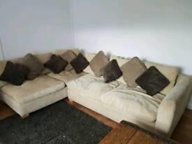 Large L shaped loft sofa and puffet