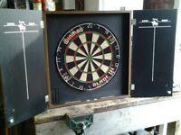Winmau Blade 111 complete staple free dart board in cabinet.Unicorn heavy duty ochi mat,with darts.