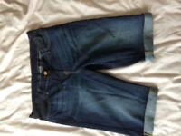 Next, Size 8, above the knee length, under the bump waistband. Great condition as never worn!