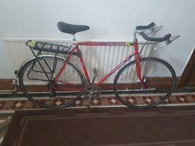 Peugeot red vintage road bike